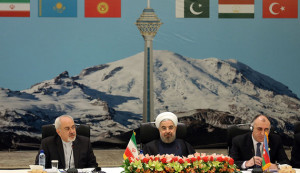 Seated between Iranian Foreign Minister Mohammad Javad Zarif (L) and Azerbaijan's Foreign Minister Elmar Mammadyarov (R), the Islamic republic's President Hassan Rouhani opens a two-day ministerial conference of the Economic Cooperation Organisation (ECO), which groups 10 Asian and Eurasian countries, in Tehran on November 26, 2013.      AFP PHOTO / ATTA KENARE        (Photo credit should read ATTA KENARE/AFP/Getty Images)