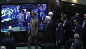 Iranian President Hassan Rouhani (C) arrives at parliament before presenting the proposed annual budget in Tehran on December 7, 2014. Iran's parliament has adopted a law on December 4, to tax religious foundations and military-linked companies, a first for the Islamic republic that could generate hundreds of millions of dollars in revenues, media reported. AFP PHOTO/ATTA KENARE        (Photo credit should read ATTA KENARE/AFP/Getty Images)