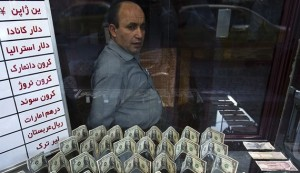 EDITORS' NOTE: Reuters and other foreign media are subject to Iranian restrictions on leaving the office to report, film or take pictures in Tehran.  An exchange currency dealer sits at his shop as he waits for customer in Tehran's business district October 24, 2011. Iranian media reported last week that monetary authorities had reversed a six-month-old decision to cut interest on bank deposits, aiming to mop up excess cash in the economy and halt a dangerous rise of inflation. The news made sense to economists, who said April's interest rate cut had pushed Iranians to withdraw their savings and rush to buy dollars and gold as a safeguard against inflation -- creating heavy pressure for the rial currency to depreciate. To match Analysis IRAN-ECONOMY/  REUTERS/Raheb Homavandi  (IRAN - Tags: BUSINESS) - RTR2T7ZD