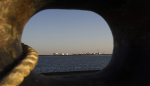 EDITORS' NOTE: Reuters and other foreign media are subject to Iranian restrictions on leaving the office to report, film or take pictures in Tehran.  A general view of an oil dock is seen from a ship at the port of Kalantari in the city of Chabahar, 300km (186 miles) east of the Strait of Hormuz January 17, 2012. REUTERS/Raheb Homavandi  (IRAN - Tags: SOCIETY) - RTR2WFMH