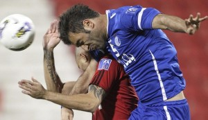 Qatar's Al-Rayyan player Afonso Alves Martins fights for the ball with Iran's Al-Esteghlal player Soheil Omran Zadeh (R) during their AFC Champions League soccer match at the Al-Rayyan Stadium in Doha March 6, 2012. REUTERS/Stringer  (QATAR - Tags: SPORT SOCCER TPX IMAGES OF THE DAY) - RTR2YXIZ