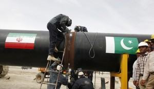Irani workers weld the pipeline during a groundbreaking ceremony to mark the inauguration of the Iran-Pakistan gas pipeline, in the city of Chahbahar in southeastern Iran March 11, 2013. Ahmadinejad and Zardari marked the start of Pakistani construction on the much-delayed gas pipeline on Monday, Iranian media reported, despite U.S. pressure on Islamabad to back out of the project. REUTERS/Mian Khursheed  (IRAN - Tags: POLITICS ENERGY BUSINESS) - RTR3EUST