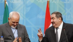 Iran's Foreign Minister Mohammed Javad Zarif (L) and Iraq's Foreign Minister Hoshiyar Zebari attend a joint news conference in Baghdad January 14, 2014. REUTERS/Thaier Al-Sudani (IRAQ - Tags: POLITICS) - RTX17DOX