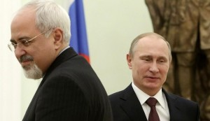 Russian President Vladimir Putin (R) passes Iran's Foreign Minister Mohammad Javad Zarif during their meeting in Moscow's Kremlin January 16, 2014. REUTERS/Sergei Karpukhin (RUSSIA - Tags: POLITICS) - RTX17GFG