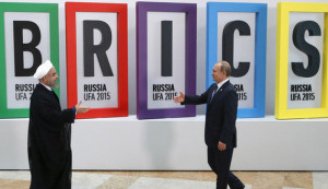 Russian President Vladimir Putin (R) greets Iran's President Hassan Rouhani in Ufa, Russia, July 9, 2015. Rouhani said on Thursday he was grateful to Russia for its efforts to secure an agreement at talks between six major powers and Iran on Tehran's nuclear program.    REUTERS/Sergei Karpukhin      TPX IMAGES OF THE DAY      - RTX1JQOA