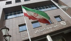 An Iranian flag flutters in front of the head office of the Export Development Bank of Iran (EDBI) in Tehran November 9, 2008. REUTERS/Morteza Nikoubazl (IRAN) - RTXAEWW