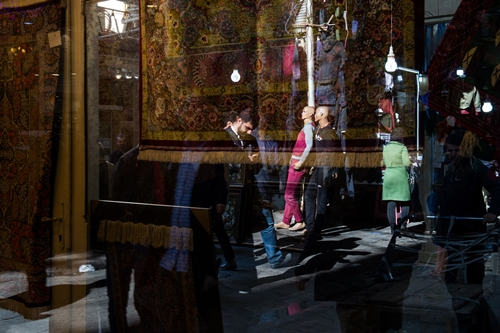 A reflection on a Rug store at Rug Bazaar, Tehran, Iran. 15-1- 2018